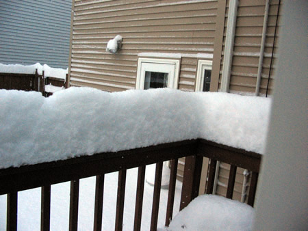 Snow on back railing